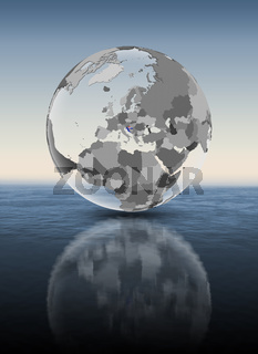 Croatia on translucent globe above water