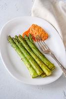 Fried asparagus with romesco sauce