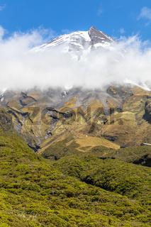 volcano Taranaki covered in clouds, New Zealand