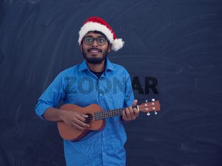 Santa playing Latin America traditional small guitar