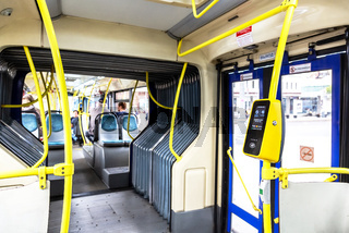 Interior of modern city bus with automatic validator