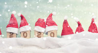 Hats of Santa with wooden blocks in snow