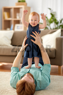 happy father with little baby girl at home