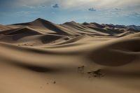 Sand dunes in Gobi Desert at sunset