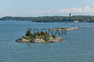 Houses surrounded by water and the banks of the Gulf of Finland near the port of Helsinki in Finland