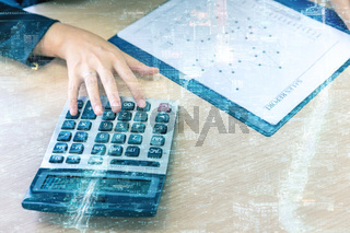 Double exposure business hand and calculator