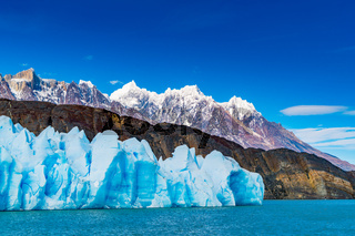 Blue Iceberg of Grey Glacier, The ripples of Grey Lake and the beautiful mountain