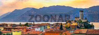 italian village skyline of Malcesine peaceful panoramic town on Garda Lake waterfront romantic horizontal panorama and idyllic picturesque castle