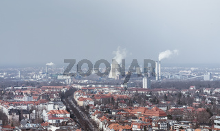 skyline of Berlin with power plant and smog