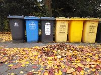 Bonn Germany, 12 November 2019: Row of Trash dumpsters in the autumnal street waits for service