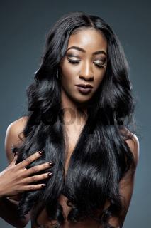 Black beautiful woman with long luxurious shiny hair