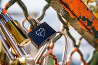 Love Paris Padlocks hanging on a fence