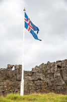 Iceland flag in National Park on a cloudy day