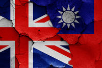 flags of UK and Taiwan painted on cracked wall