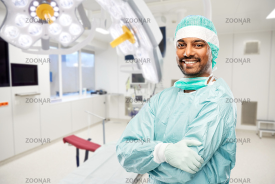 smiling indian male doctor or surgeon at hospital