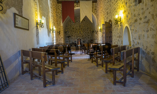 Interior of a medieval castle in Toledo, Spain. Stone rooms with wooden furniture, medieval period of the Spanish reign