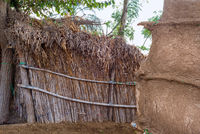 Bamboo hut with straw roof and clay wall at traditional Egyptian village on sunny day