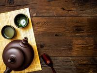 Teapot on the bamboo mat. Top view