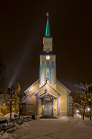 Tromsø Cathedral with falling snow by night
