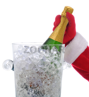 Santa Claus hand taking a champagne bottle in a cyrstal ice bucket isolated on white.