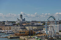 Pier, Ferris wheel and Cathedral of the Diocese of Helsinki, finnish Evangelical Lutheran church, located in the neighborhood of Kruununhaka in Helsinki, Finland