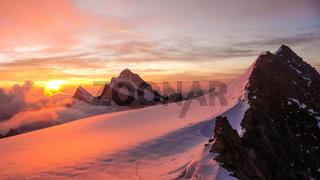 sunrise over an alpine mountain landscape in Switzerland