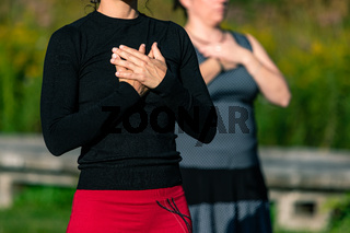 Two sporty females warming up for a workout