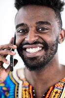 african man on phone