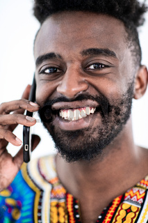 african man on phone