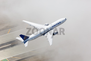 United Airlines Boeing 777-200 airplane Los Angeles airport aerial view