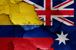 flags of Colombia and Australia painted on cracked wall