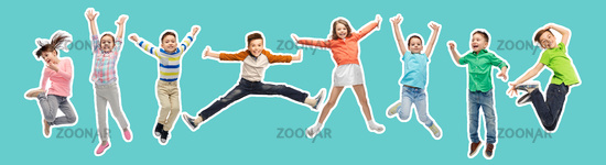 happy kids jumping in air over blue background