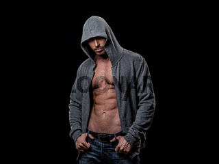Muscular man in gray hoodie