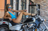 Brazilian Blonde Bikini Model Posing Outdoors With A Motorcycle