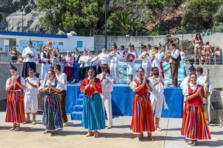 Dancers demonstrating a folk dance at the beach of Funchal, Madeira Island
