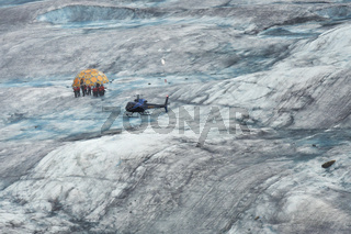 Helicopter And A Group Of Hikers On Mendenhall Glacier, Juneau, AK