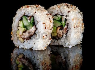 Closeup two sushi rolls california