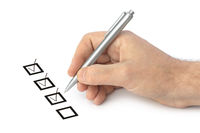Hand with pen and check boxes