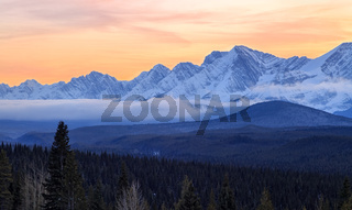 A beautiful sunset over snow covered mountains in Kananaskis in the Canadian Rocky Mountains, Alberta