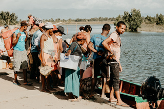 people wait for taxi boat, Maroantsetra Madagascar