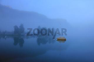 Misty summer morning at Lake Brienz, Switzerland.
