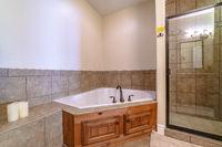 Interior of a modern bathroom with corner bath