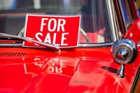 FOR SALE red sign on classic antique car