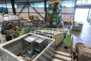 Bucharest, Romania - October, 2013: Used computers on an escalator, ready to be disassembled for recycling, inside a recycling plant