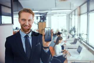 Businessman with a phone in his hands