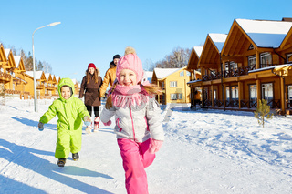 Children enjoying winter walk