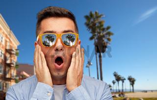 surprised man in sunglasses over venice beach