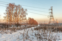 Winter suburban landscape with power line