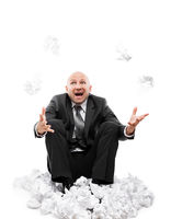 Angry businessman in depression hand throwing crumpled torn paper document