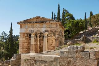 The Athenian treasury in Delphi, Greece in a summer day.